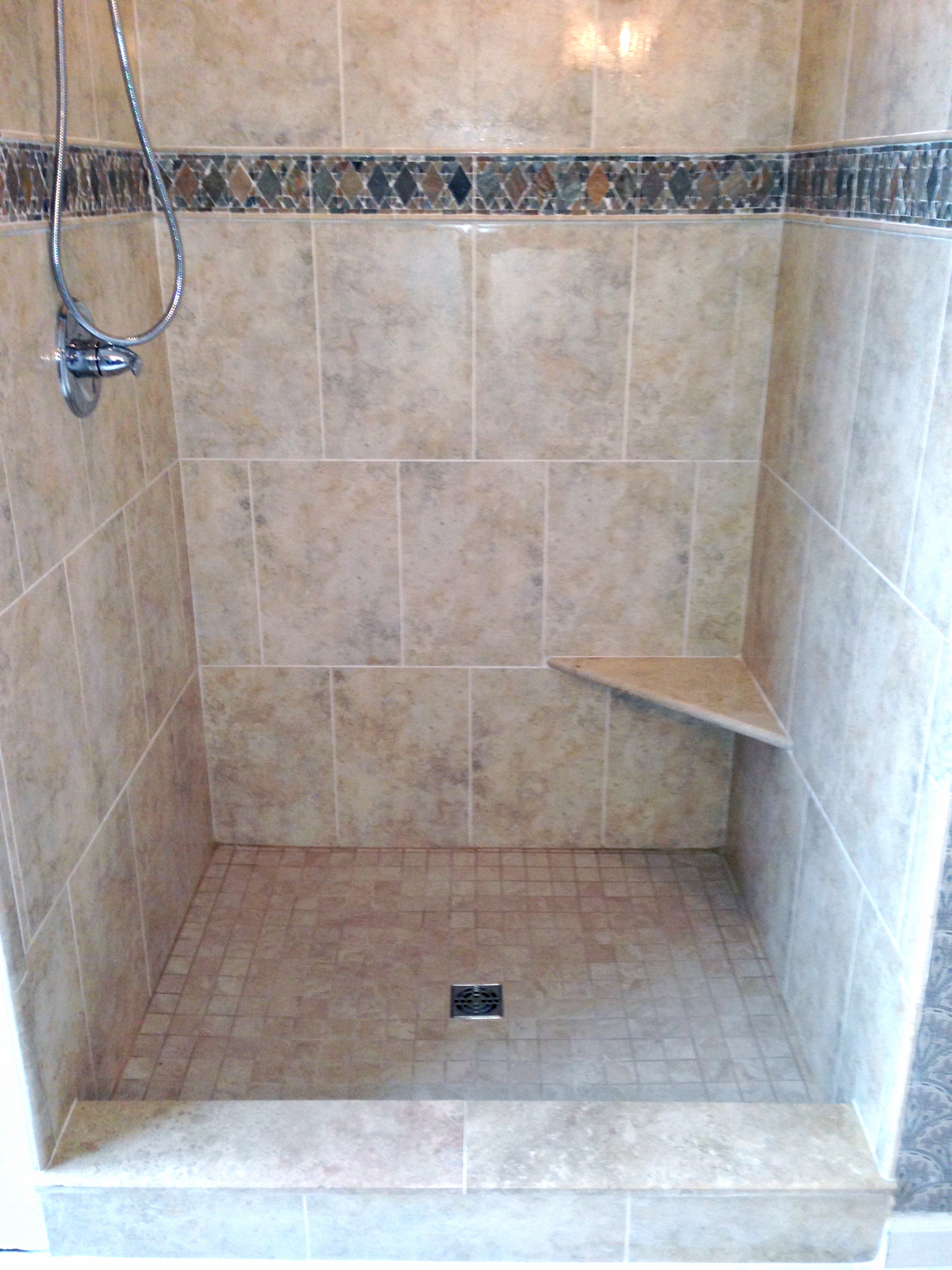 Tile flooring complete custom tiling stone shower with diamond tile inset interior dailygadgetfo Image collections